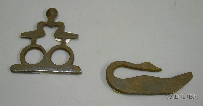 Two Wrought Iron Figural Flint Strikers