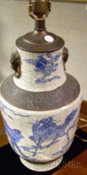 Chinese Champleve Lamp, a Metal-mounted Sang de Boeuf Glazed Ceramic Vase/Table Lamp, and a Chinese Blue and Wh...
