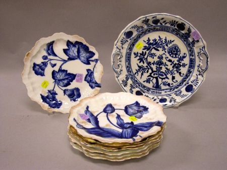 Set of Eight Gilt Flow Blue Floral Porcelain Plates and a Blue Onion Pattern Platter.