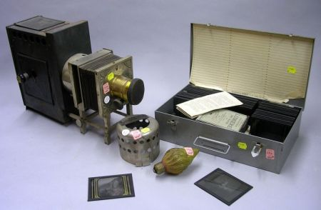 Schwann Magic Lantern, Instructions, and a Box of Approximately Forty-two Glass Positives.