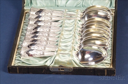 "Boxed Set of Twelve George W. Shiebler & Co. Sterling ""Amaryllis"" Teaspoons"