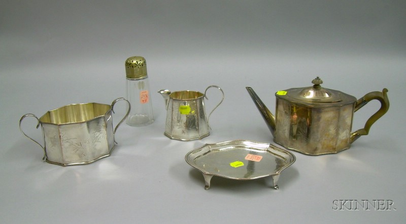 Four-piece Sheffield Silver Plated Tea Set and a Silver Plate Mounted Cut Glass Muffineer.