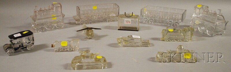 Twelve Colorless Pressed Pattern Glass Figural Table Items and Containers
