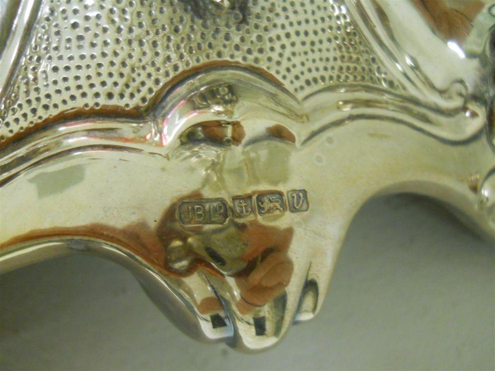 Pair of Elizabeth II Sterling Silver Six-light Candelabra