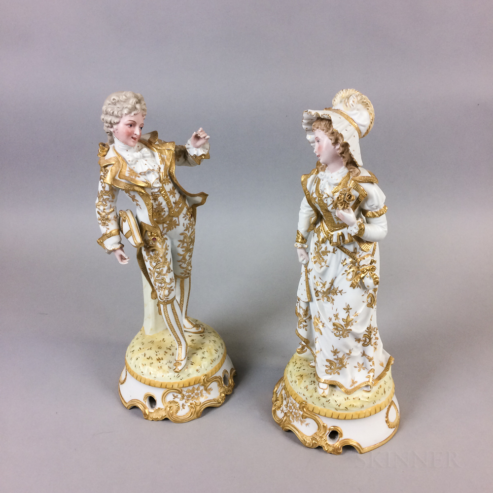 Pair of Continental Gilt Bisque Porcelain Figures