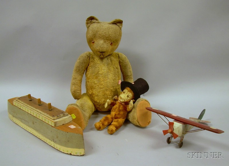Stuffed Toy Teddy Bear, Monkey with Top Hat, a Folk Painted Wooden Airplane, and Wooden Boat.