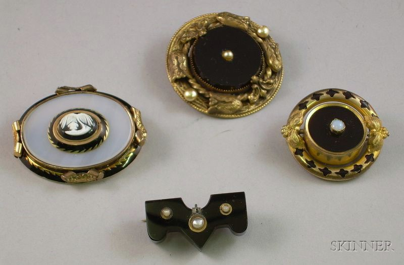Four Victorian Onyx Mourning Brooches