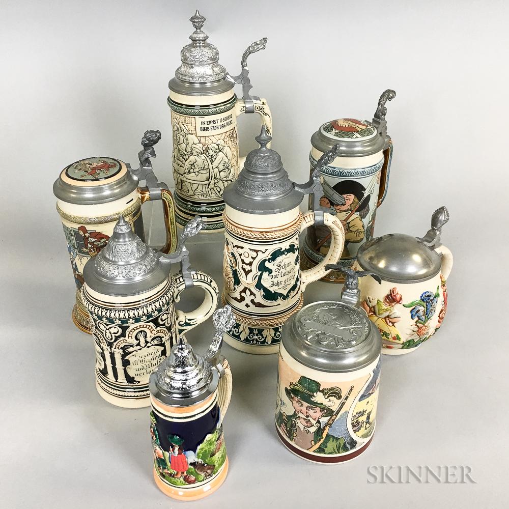 Eight Pictorial Stoneware Steins