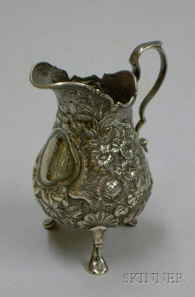 American Repousse Sterling Silver Footed Cream Jug.