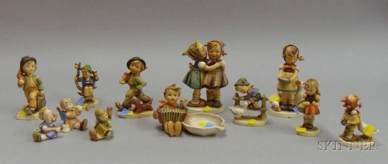 Approximately Twelve Hummel/Goebel Figural Pieces.      Estimate $100-150
