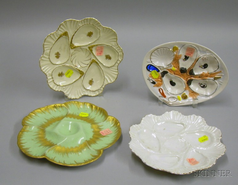 Four Gilt and Hand-painted Ceramic Oyster Plates.