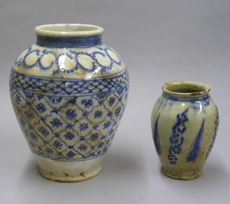 Two Persian Blue and White Decorated Faience Vases.