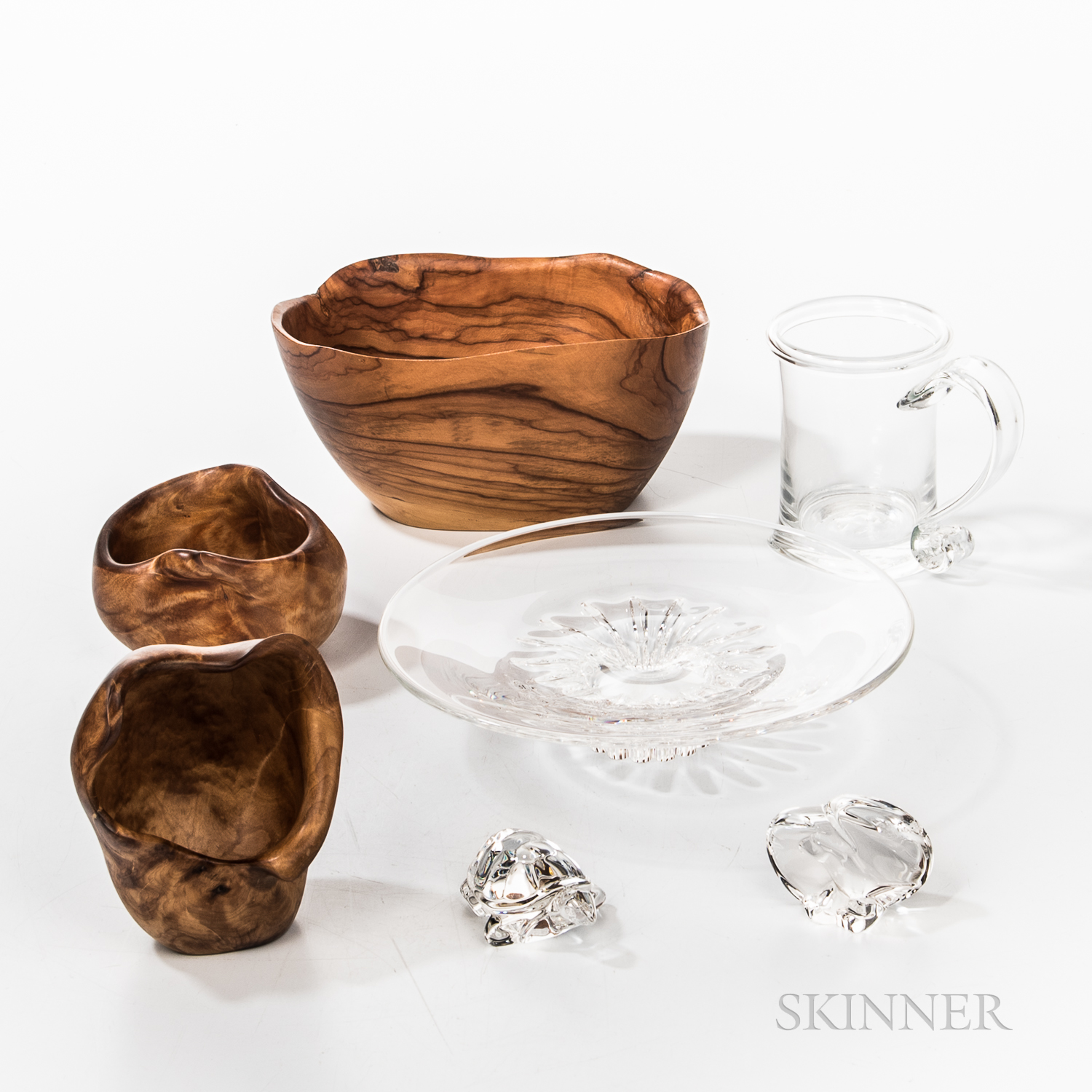 Steuben Colorless Glass Tazza and Two Animals, a Simon Pearce Mug, and Three Turned Wood Bowls.     Estimate $150-250