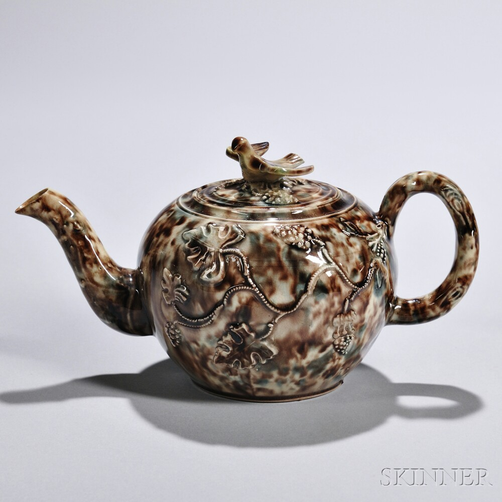 Cream-colored Earthenware Teapot and Cover