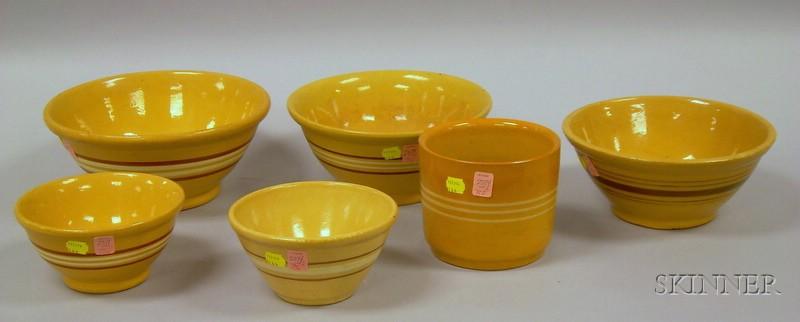 Five Banded Yellowware Mixing Bowls and a Crock.