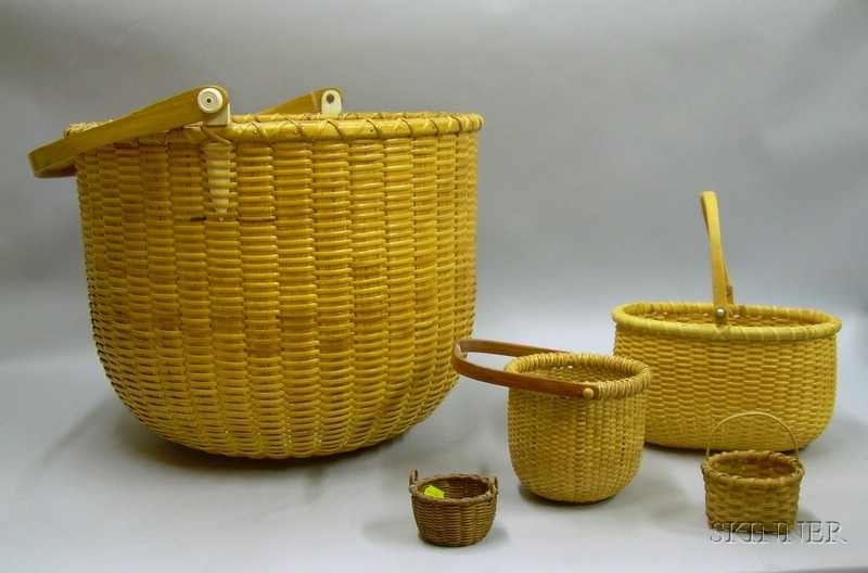 Three Reproduction Nantucket Swing-handle Baskets and Two Miniature Woven Splint Baskets.