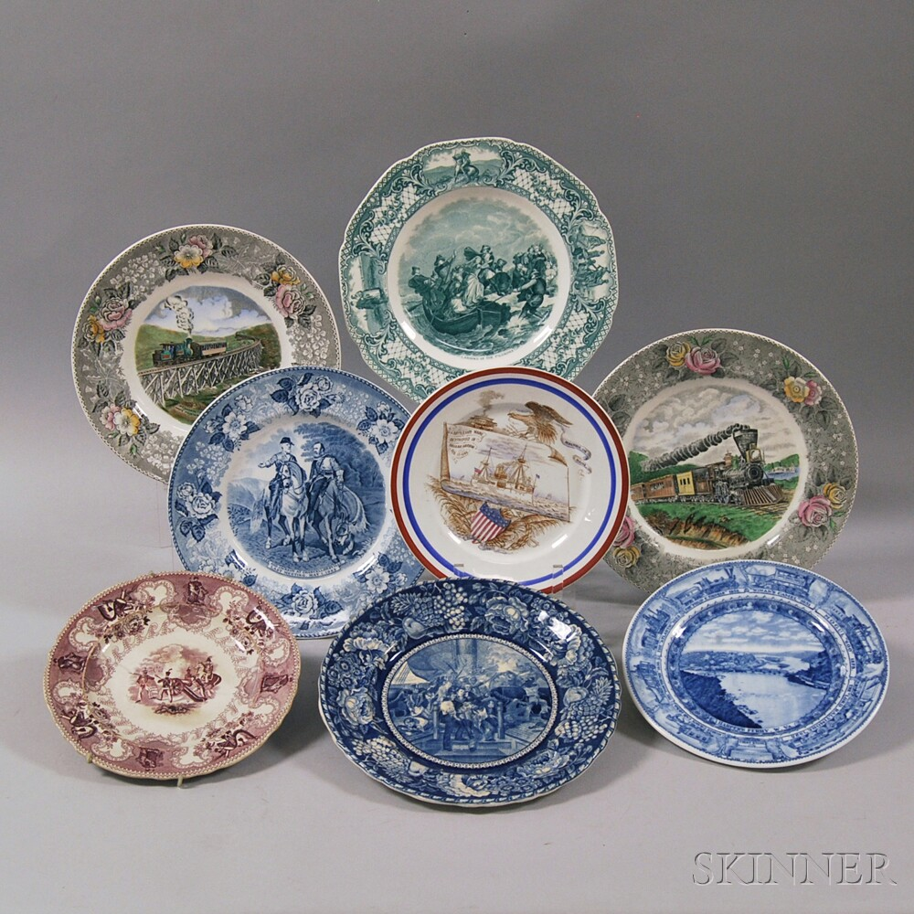 Eight Mostly Military and Railroad-themed Transfer-decorated Ceramic Plates