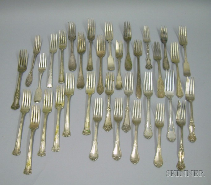 Approximately Thirty-four Assorted Sterling Silver Forks.