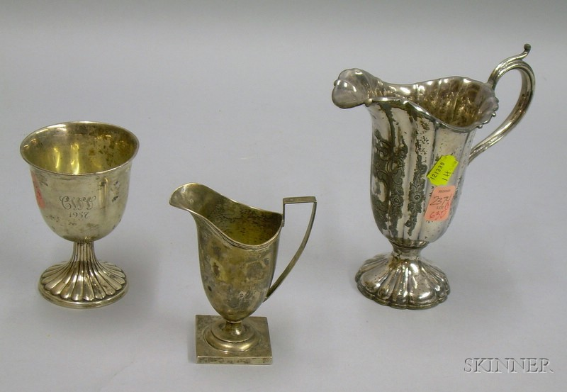 Sterling Silver Footed Cup, Creamer, and a Silver Plated Jug.