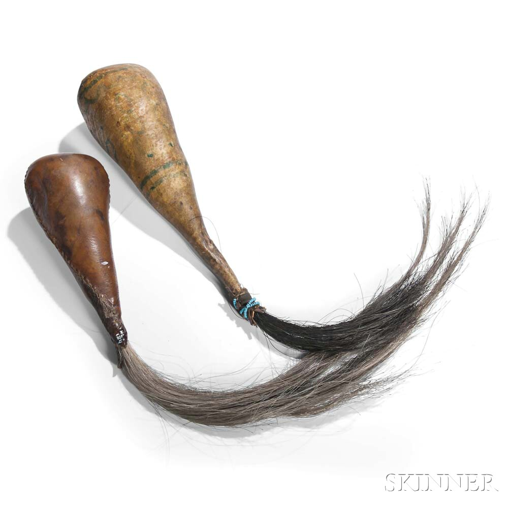 Two Hide Rattles with Horsehair Drops