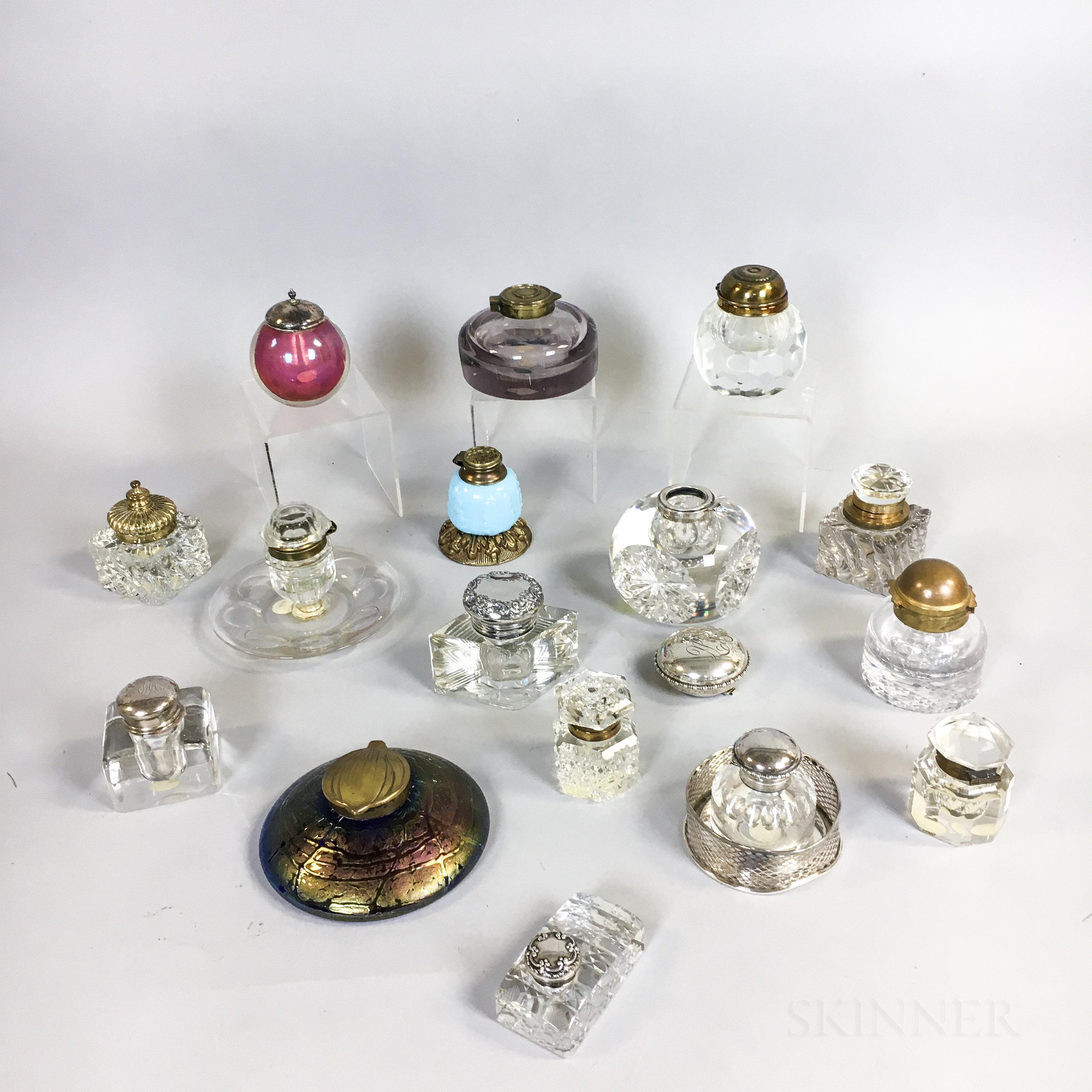 Sixteen Metal-mounted Glass Inkwells and Ink Stands