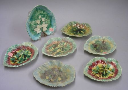 Set of Six Majolica Glazed Leaf-form Dishes and a Tray.