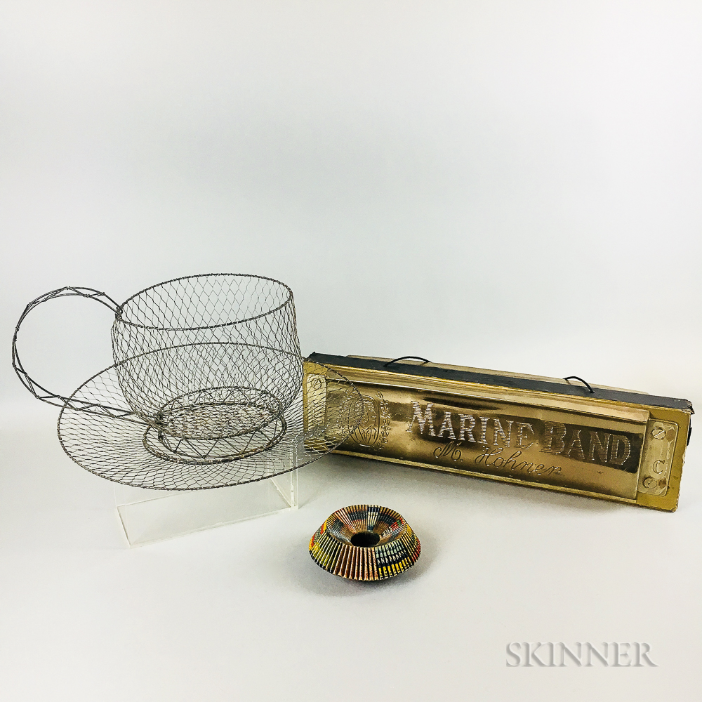 Large Wirework Teacup and Saucer, a Matchbook Ring, and an Advertising Marine Bank Harmonica.     Estimate $200-300