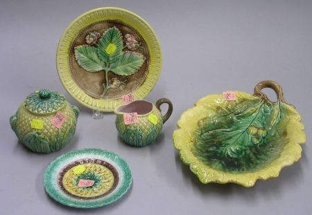 Majolica Pineapple-form Creamer and Sugar, Two Majolica Plates, and a Leaf-form Tray with Acorns.