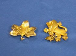 Two 14kt Gold Pins.