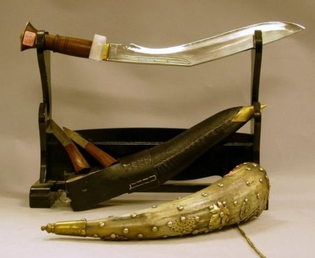 Tacked Brass Decorated Powder Horn, a Kukri Knife, and a Wooden Sword Stand.