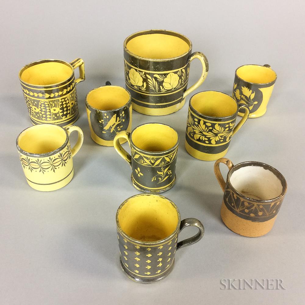 Nine Yellow-glazed Silver Lustre Ceramic Cups
