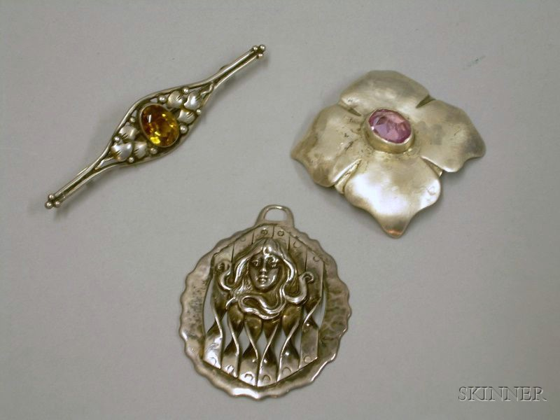 Two Sterling Silver Arts & Crafts Brooches and an Art Nouveau Pendant.