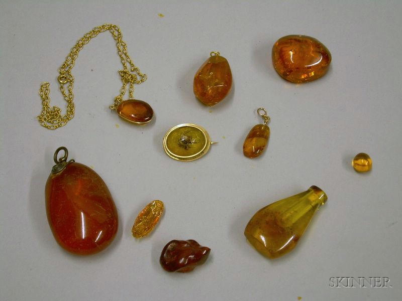 Four Amber Pendants, and Spider Trapped in Amber Pin, an Amber Perfume, and Three Loose Amber Pieces.