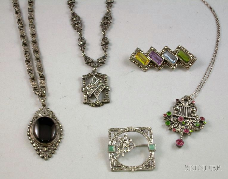 Three Silver and Marcasite Pendant Necklaces and Two Brooches.