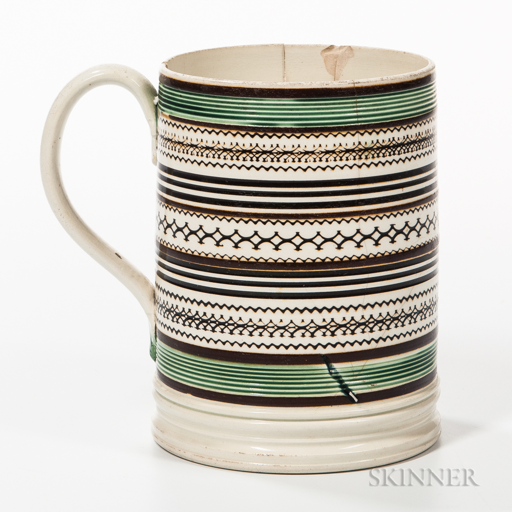 Slip-decorated and Rouletted Quart Mug