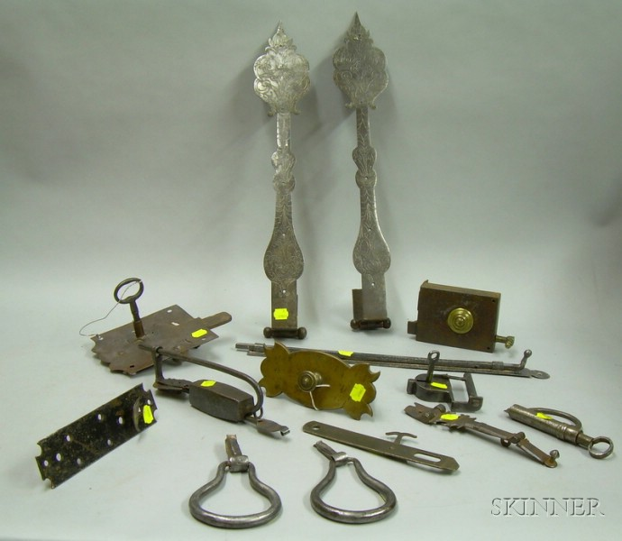 Fourteen Pieces of Early Iron and Brass Door Hardware