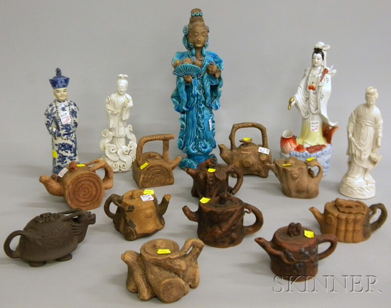 Eleven Asian Ceramic Teapots and Five Figures