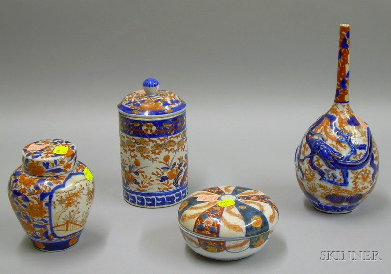 Imari Porcelain Bottle Vase, Two Covered Jars, and a Covered Box.