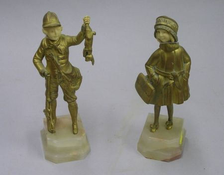 Gilt Bronze and Carved Ivory Figure of a Young Girl and a Gilt Bronze and Carved   Ivory Figure of a Young Boy Hunter