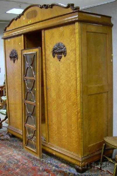 Biedermeier-style Carved Walnut-mounted Blonde Wood Veneer Two-Door Armoire.