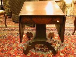 Classical Mahogany Drop-leaf Pedestal Table.