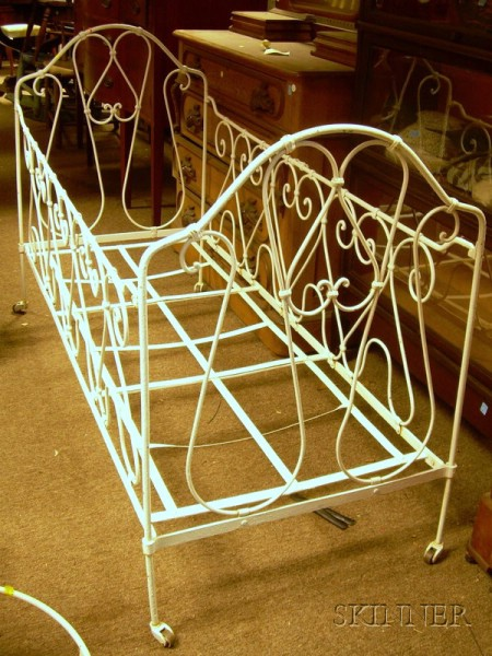 White-painted Victorian Iron Scrollwork Crib, an Iron Washstand, and Three Iron Baskets.