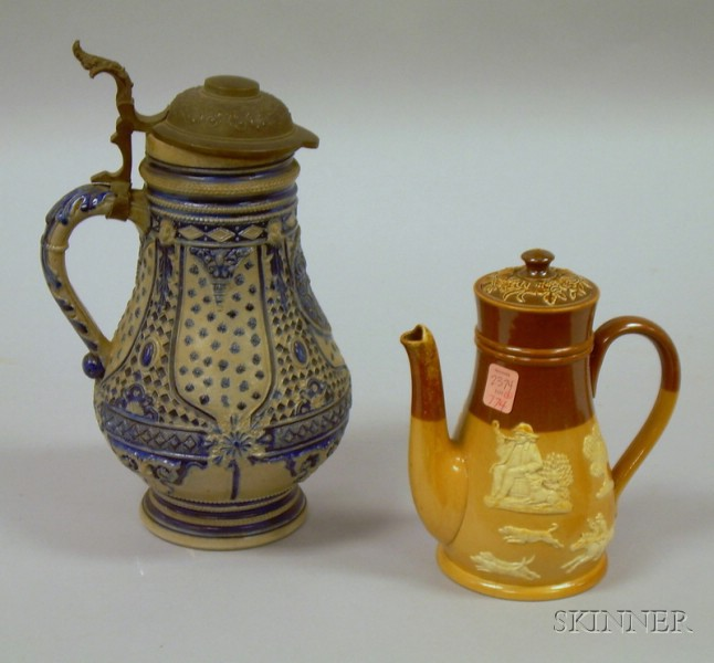 German Cobalt Highlighted Stoneware Flagon and a Doulton Lambeth Glazed Stoneware Teapot.