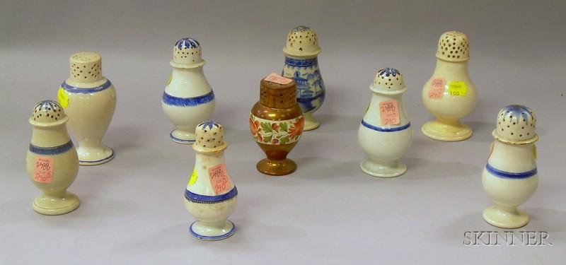 Nine Leeds and Staffordshire Pepper Pots.