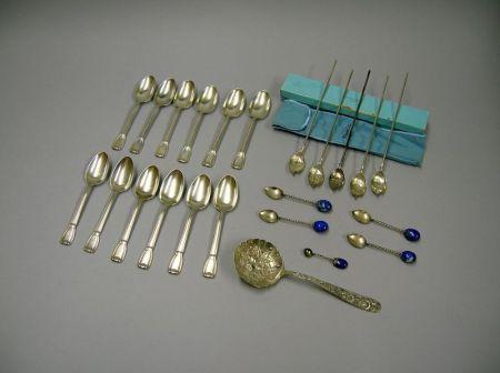 Set of Five Tiffany & Co. Sterling Silver Iced Tea Spoons and a Set of Twelve Tiffany & Co. Sterling Silver Castilian Pattern Teaspoons