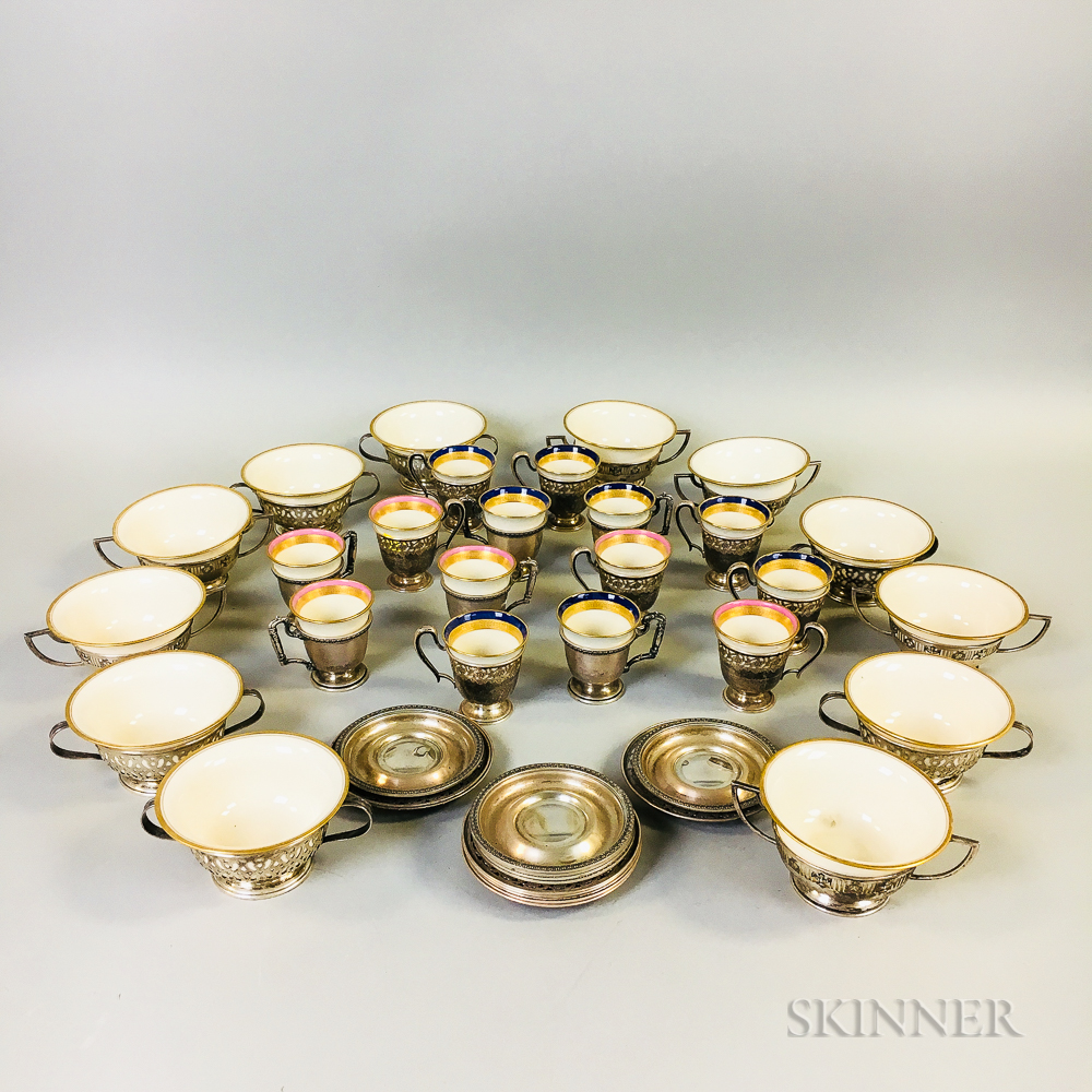 Twenty-six Lenox Sterling-mounted Teacups, Coffee Cups, and Saucers