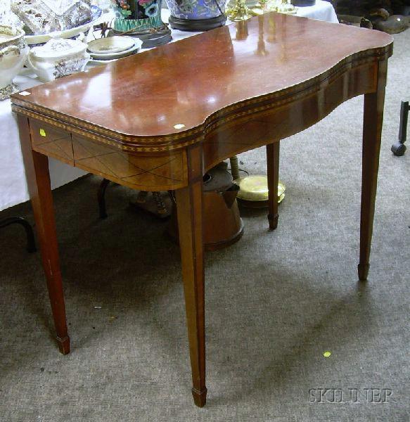 Regency-style Inlaid Mahogany and Mahogany Veneer Games Table.