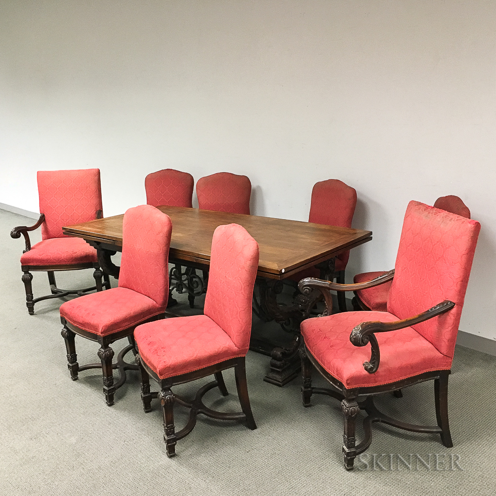 Louis Philippe-style Carved and Upholstered Walnut Dining Suite.     Estimate $20-200