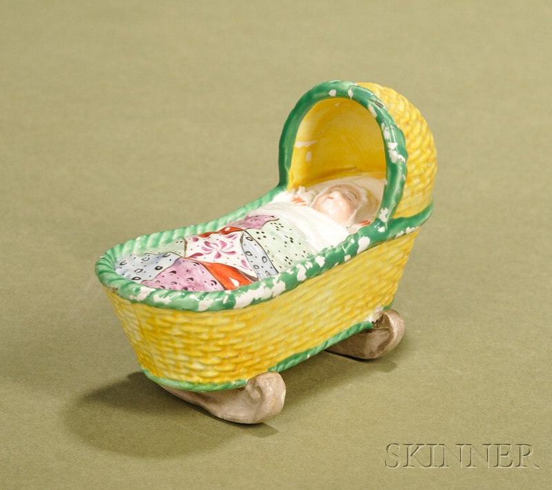Staffordshire Canary Luster Baby in Cradle