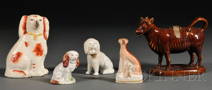 Four Staffordshire Dogs and a Cow Creamer